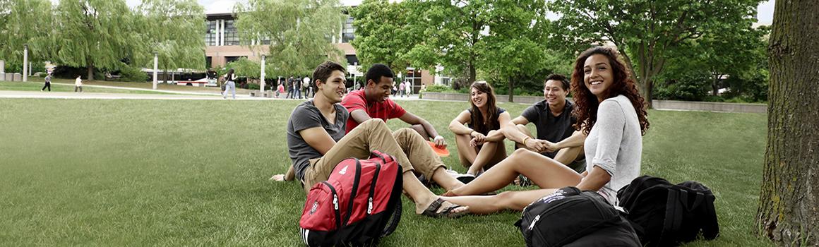 York U students sitting on the grass